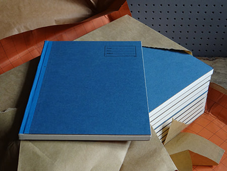 vintage blue covered exercise books
