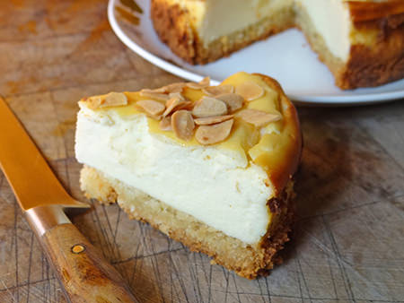 Slice of home-made Italian cheesecake with almond crumb base | H is for Home