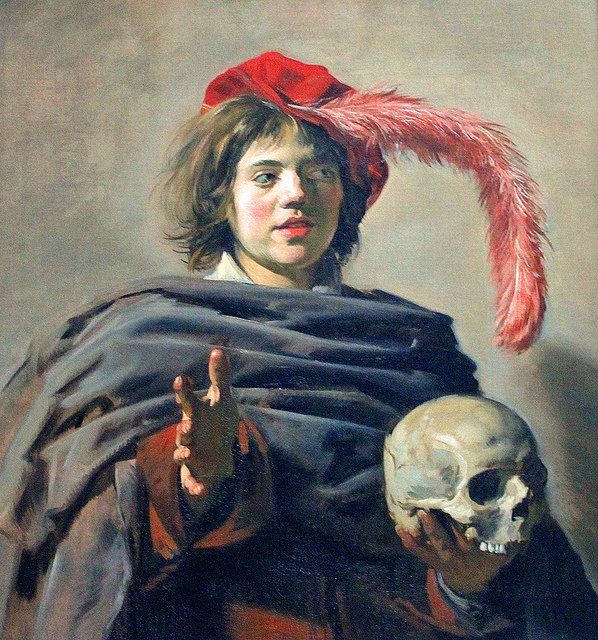 Portret van een jongeman met een schedel
