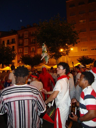 Drummers and revelers on the illuminated Castle square - San Fermín - Pamplona, Spain (16), backpacking and hitch-hiking in Spain