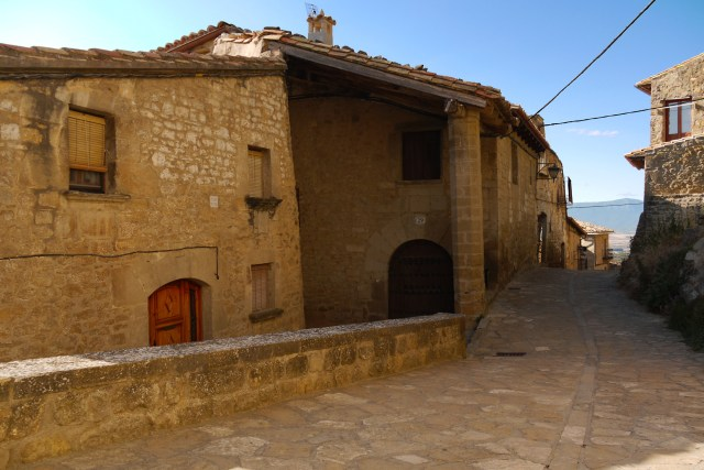 Stone houses and pillar on Calle Gil de Jaz - Sos del Rey Catolico, Spain