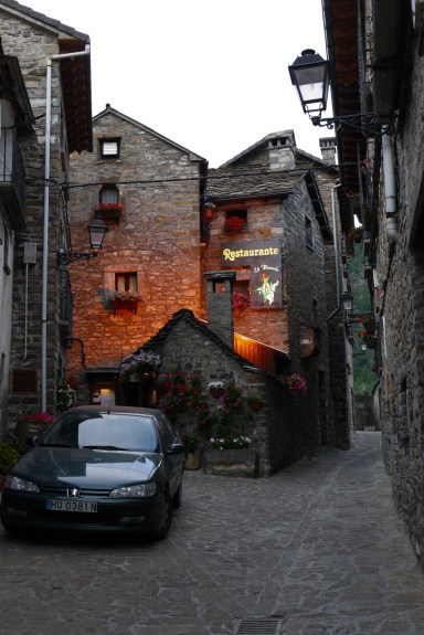Restaurant in orange light, in one of the narrow alleys of Torla - Torla, Spain (2)