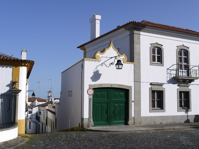 White house with green garage on cobblestone road - Evora, Portugal (53), Hitch-hiking in Portugal