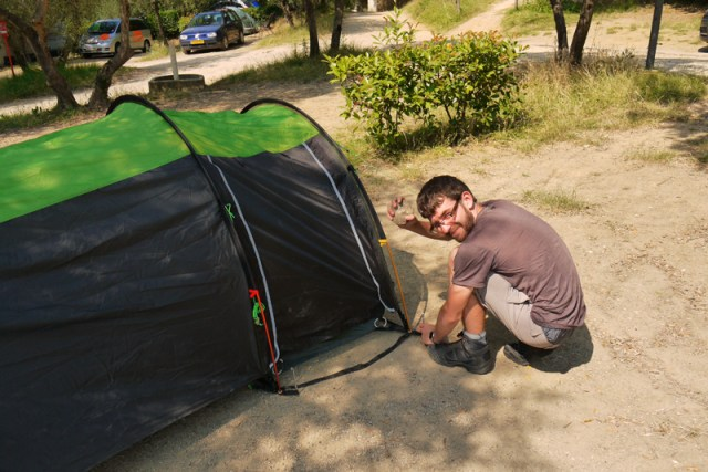 Jon pitching the tent in Florence, Italy - small, backpacking in Italy
