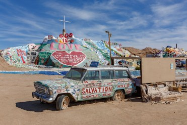 "Salvation Mountain with the ""visitor's center"" in the foreground"