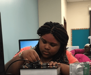 Youth from Dunne Technology Academy learn, build, and code their own smart lamp during Energy Engineers - a collaboration among Project SYNCERE, Freedom Games, and University of Chicago's RDCEP.