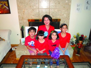 Dr. Irella Perez celebrates the Christmas holiday with her four children at their Whittier home.  Tammye McDuff Photo.