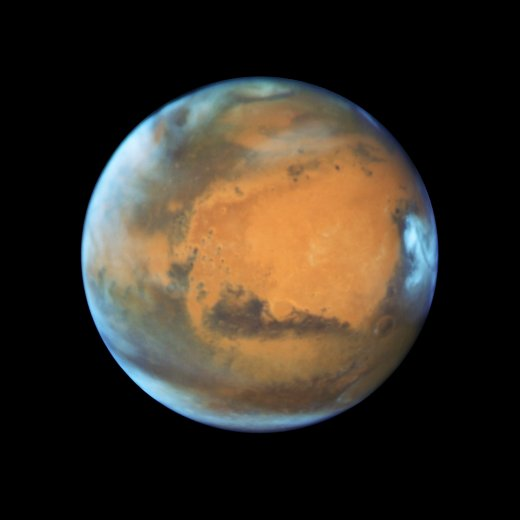 This image shows our neighbouring planet Mars, as it was observed shortly before opposition in 2016 by the NASA/ESA Hubble Space Telescope. Some prominent features of the planet are clearly visible: the ancient and inactive shield volcano Syrtis Major; the bright and oval Hellas Planitia basin; the heavily eroded Arabia Terra in the centre of the image; the dark features of Sinus Sabaeous and Sinus Meridiani along the equator; and the small southern polar cap.