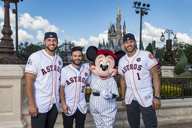 Houston Astros star players (l-r) World Series MVP George Springer, American League batting champion Jose Altuve and All-Star Carlos Correa team up with Mickey Mouse for a World Series victory parade Saturday, Nov. 4, 2017, at Magic Kingdom Park in Lake Buena Vista, Fla. The Walt Disney World Parade saluted the teamÕs first world title in its 56-year history.