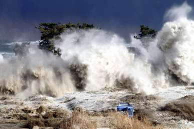 This picture taken on March 11, 2011 by Sadatsugu Tomizawa and released via Jiji Press on March 21, 2011 shows tsunami waves hitting the coast of Minamisoma in Fukushima prefecture. The number of people confirmed dead or listed as missing in Japan neared 22,000, 10 days after a massive earthquake and tsunami struck the country's northeast coast.  AFP PHOTO / JIJI PRESS (Photo credit should read SADATSUGU TOMIZAWA/AFP/Getty Images)