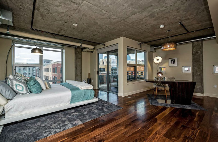 E Contemporary Loft Bedroom With Balcony Wood Floors Concrete