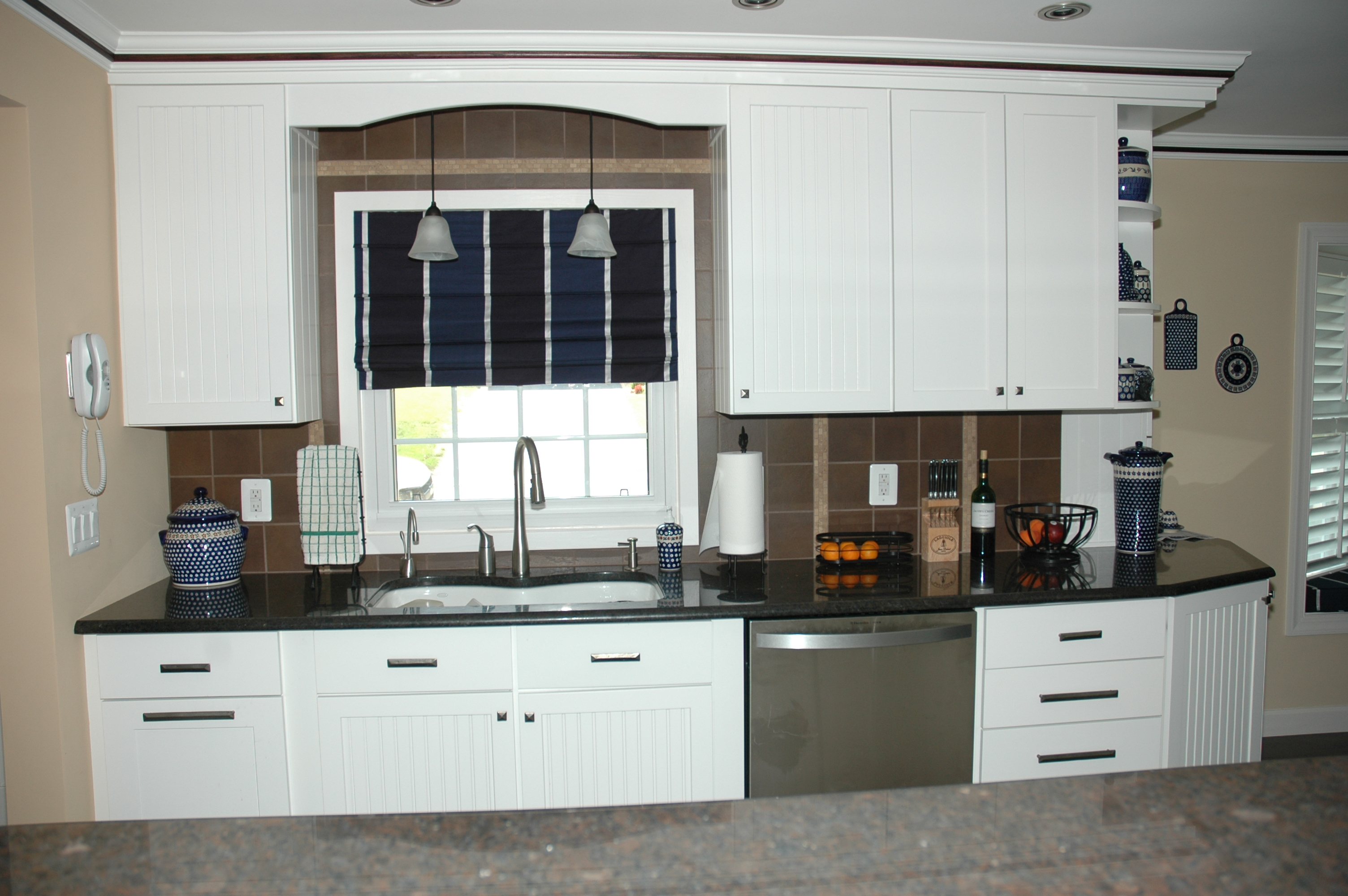 kitchen remodeling northern va with white wood cabinets plus black marble countertop plus sink and pendant lamps and kitchen stuff