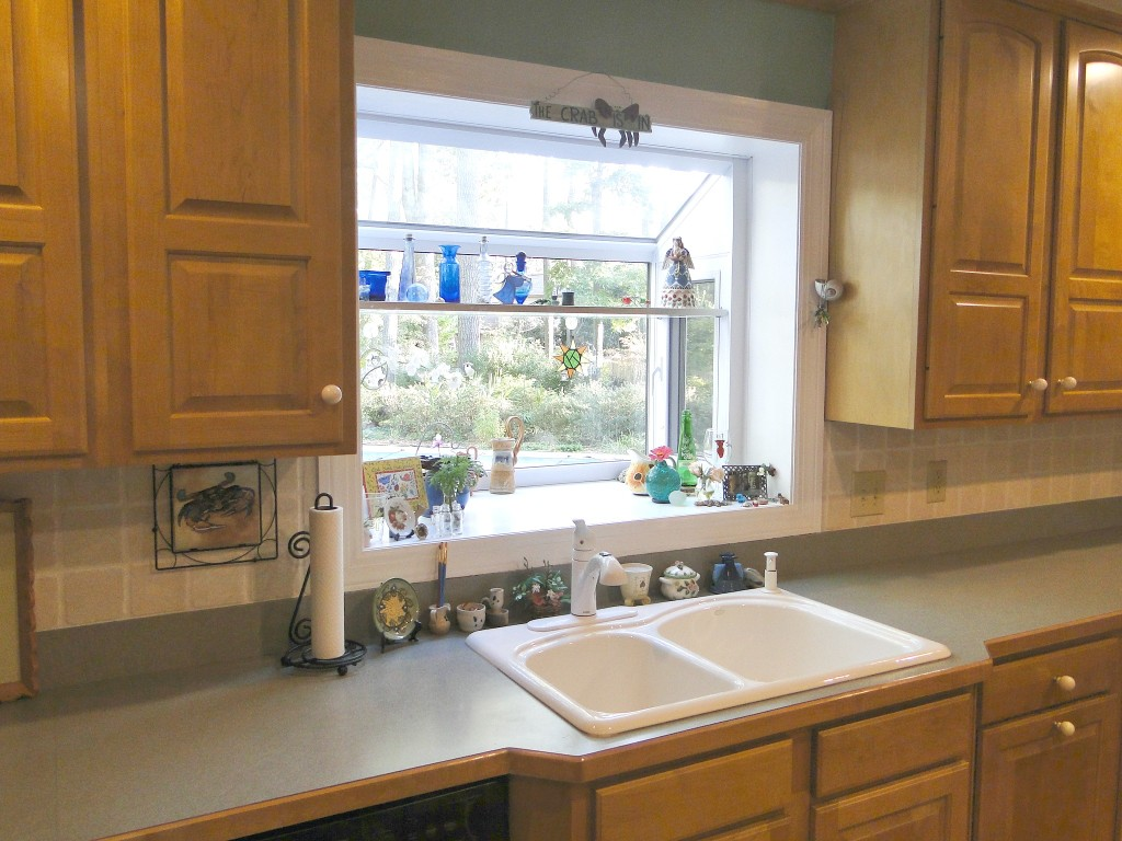 fascinating garden windows for kitchens beautified with ceramics on glass shelf installed above kitchen sink with ceramic sink and laminate countertops and paper towel holder