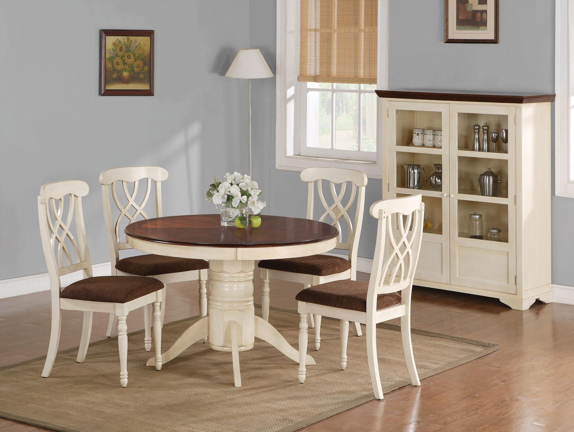White Round Wooden Kitchen Table With Chairs And Flower Brown Carpet Standing Lamp At Room Corner White Cabinet On Grey Wall Painted