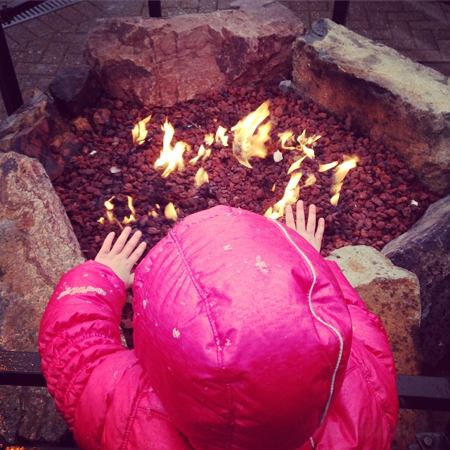Staying warm by the fire as the snow falls!