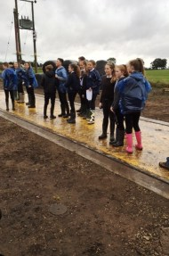 Pupils try out the new weigh bridge used for grain