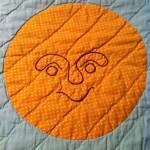 benevolent baby quilt sun