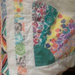 Closeup of the Pilly quilt and binding (which she made from a pillowcase, clever girl)