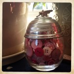 pink buttons in a pretty French condiment jar