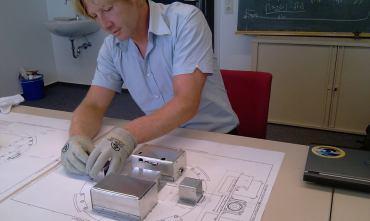 simon mawn checking the aluminium cases