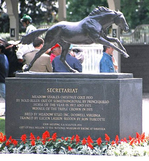 Secretariat's statue greets racing fans and jockeys in the paddock of Belmont Park.