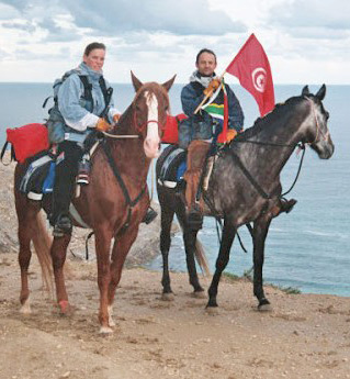 """At the beginning of the journey, in Cap Blanc, Tunisia. Prior to their departure, Christy wrote, """"The first reason for our ride is pure adventure! We want to meet everyone, learn their cultures, languages, religions and way of life. We want people to understand that they can do anything they put their mind to."""""""