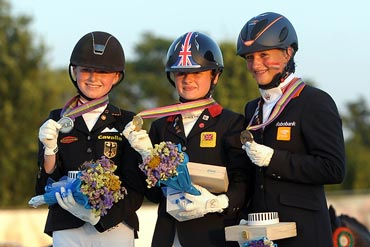 On the medal podium for Individual Dressage at the FEI European Pony Championships 2013 in Arezzo, Italy are, from left,  bronze medallist Lisanne Zoutendijk, from the Netherlands, gold medallist Phoebe Peters, from Britain, and silver medallist Semmieke Rothenberger, from Germany.  Photo: FEI/Helen Revington.