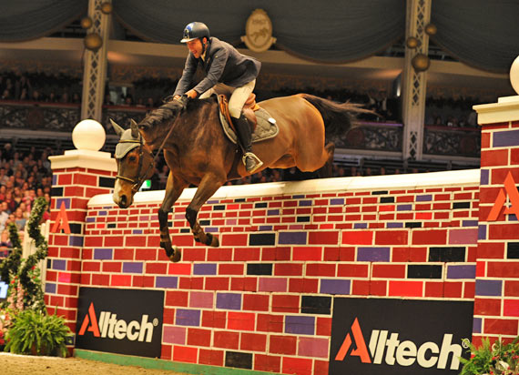 """Luca Moneta and Quovo de Vains clear 7'2"""" to win the puissance at Olympia."""