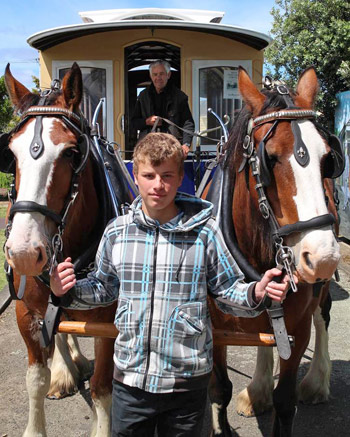 Cadge a free ride … Peter, left, and Katie with Jayden Moore, 14, foreground and Foxton Tram reinsman Jim White. The tram will be operating as a visitor ferry vehicle at Manfeild Park for this weekend's Royal A and P Show New Zealand.