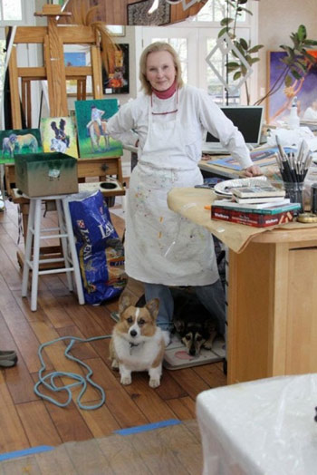 Louise Mellon in her studio with Ruffles and Cricket.
