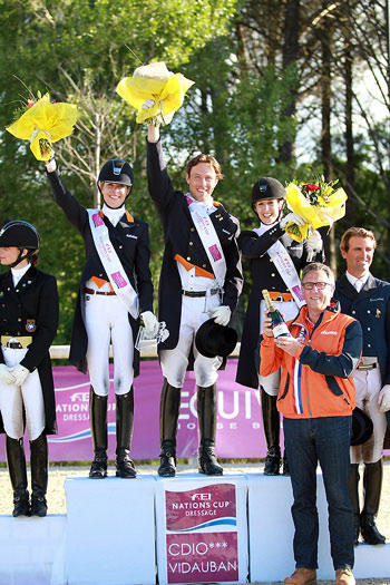 The Netherlands won the opening leg of the FEI Nations Cup Dressage pilot season at Vidauban, France last May. Pictured on the podium are Katja Gevers, Laurens van Lieren and Stephanie Peters with trainer, Wim Ernes. The Dutch went on to take the 2013 pilot series title.