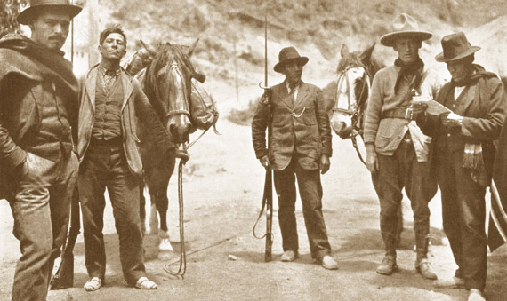 Even Aime Tschiffely (second from the right) was continually harassed by border guards during his legendary journey from Argentina to New York. Here he is seen trying to enter Ecuador.