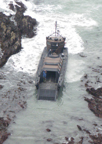 The Marine craft nears the beach to drop off the inflatable rescue path.