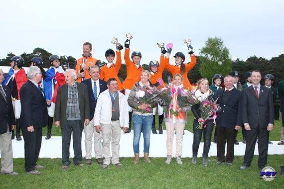 The Dutch team celebrate on the podium at Bonneau.