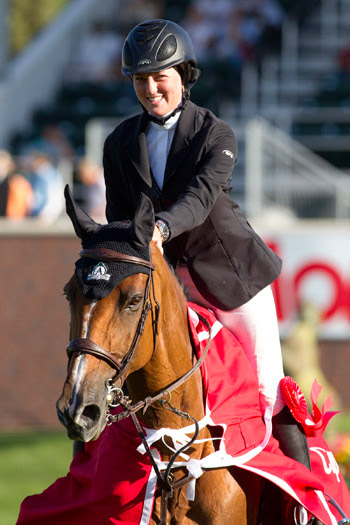 """Caitlin Ziegler, pictured at the 2011 Spruce Meadows """"North American"""" tournament when she became the youngest rider to win an FEI-sanctioned event in the International Ring at age 16."""