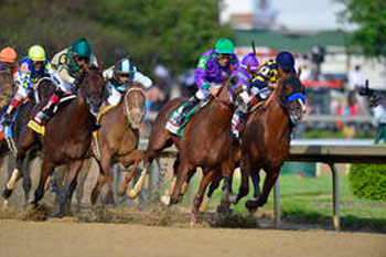 California Chrome (purple colours) heads to the front of the Kentucky Derby field.