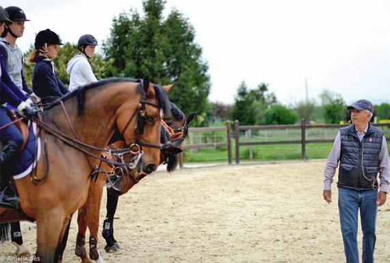 Nelson Pessoa and his students on the outdoor ring of La Renfile Stable.