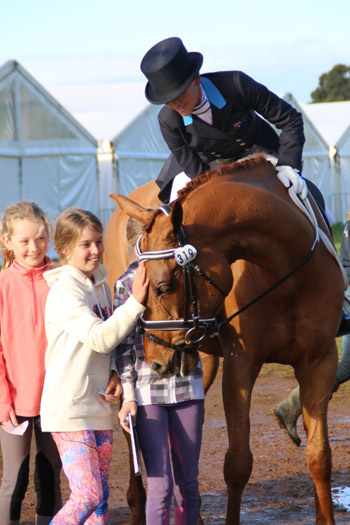 Members of the William Wordsworth fanclub meet their idol after his dressage test with Amanda Ross. They are currently in third place.