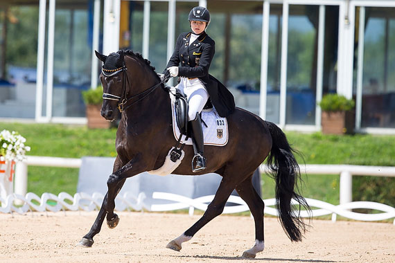 Germany's Anna-Christina Abbelen and Fuerst on Tour were triple-gold medallists at the FEI European Dressage Championships for Juniors and Young Riders 2014 at Arezzo, Italy.