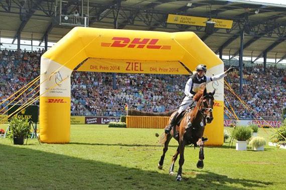 Sandra Auffarth and Opgun Louvo cross the finish line at Aachen.