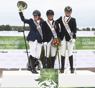 Grade III gold medalist Hannelore Brenner (GER) is flanked by silver medalist Sanne Voets (NED) and  Susanne Jensby Sunesen (DEN), who won bronze.
