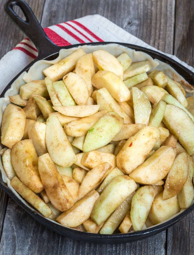 Beautiful rustic Skillet Apple Pie has a buttery crust that's filled with a delicious warm cinnamon-apple filling. | HostessAtHeart.com