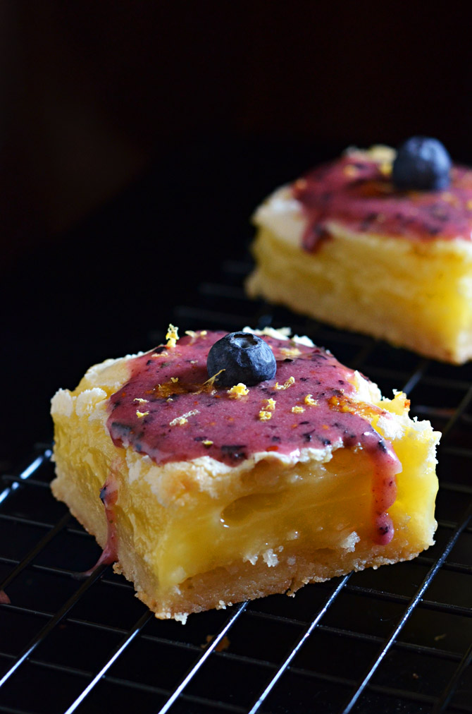 Gooey Lemon Bars with Blueberry Glaze. Tangy, sweet, rich, gooey, and out of this world.   hostthetoast.com