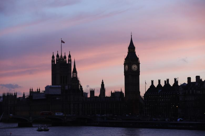 The sun sets behind the Houses of Parliament after an attack on Westminster Bridge in London