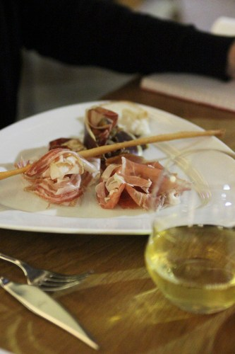 Primo.  A selection of cured meats with white wine