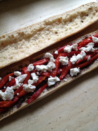 Layered in roasted capsicum strips and crumbled goat's cheese