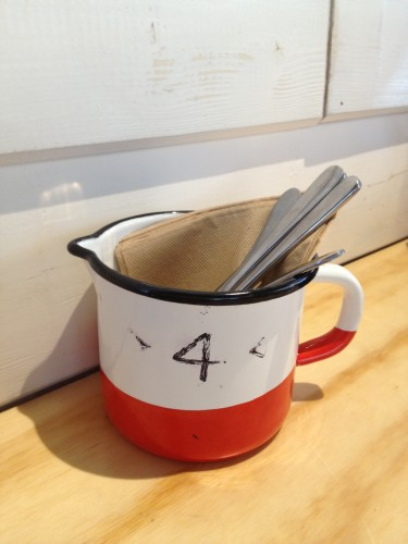 An enameled tin jug holds our cutlery as well as being our table number.