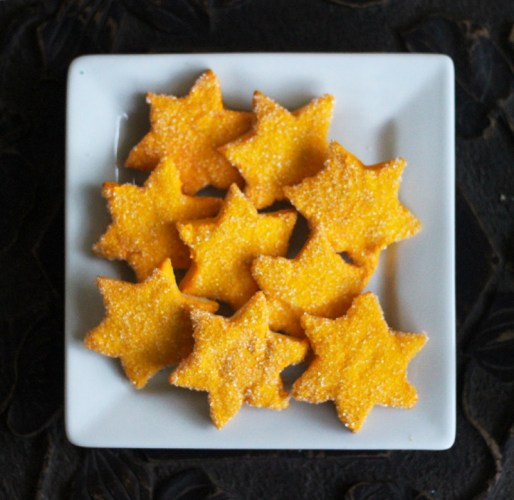 Christmas Stars iced in yellow icing then dipped in yellow sparkle sugar
