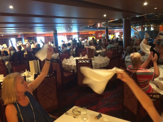 Waving our napkins in the air to salute those who had served us over the two weeks.