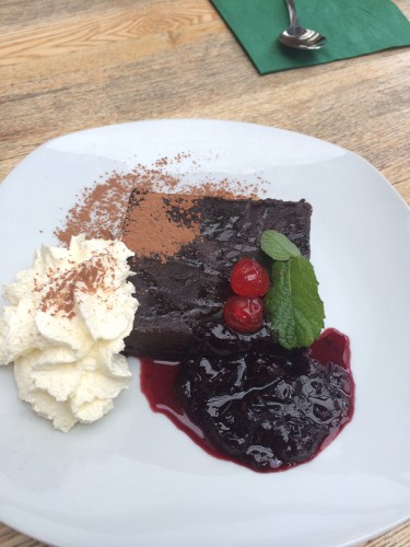 Chocolate Mud Cake with Berry Sauce and cream $10.00